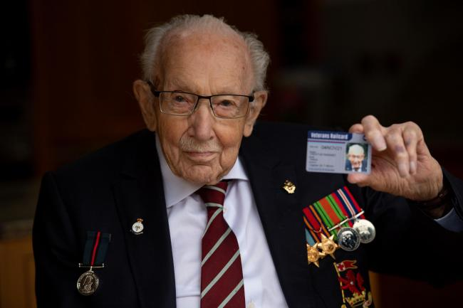 Captain Sir Tom Moore with the first veterans railcard in Marston Moretaine, Bedfordshire. The new veterans railcard will see military veterans of every generation benefit from discounted travel with up to a third off all rail fares from November 5, as we