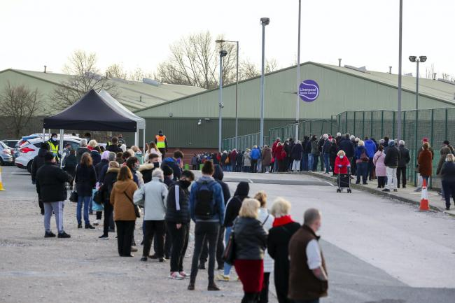 A queue at a coronavirus testing centre in Liverpool (PA)
