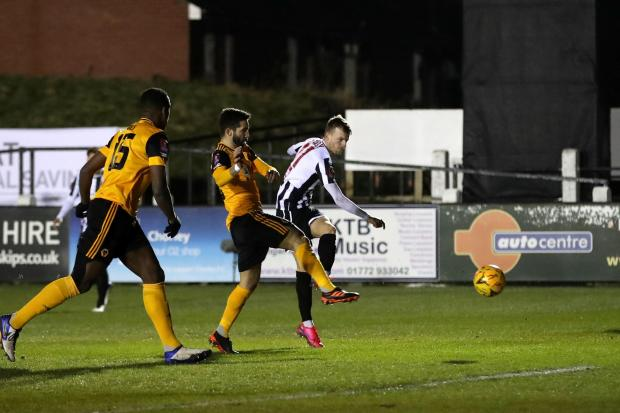 Chorley's Elliot Newby has a shot on goal in the defeat to Wolves